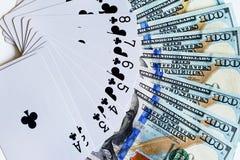Speelkaarten en dollars Stock Afbeeldingen