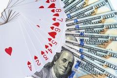 Speelkaarten en dollars Stock Foto's