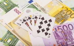 Speelkaarten en euro Stock Fotografie