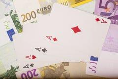 Speelkaarten en euro Stock Afbeeldingen