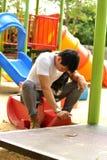 Speelplaats bij het park Stock Foto's