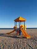 Speelplaats bij het strand Stock Foto