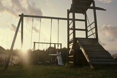 Speelplaats bij zonsondergang Stock Afbeelding