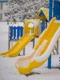 Speelplaats met sneeuw Stock Afbeelding