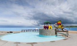 Speelplaats onder stormachtige hemel, Portrush stock foto's