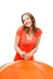 Speels glimlachmeisje met paraplu Royalty-vrije Stock Fotografie