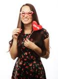 Speelse jonge vrouw klaar voor partij Stock Afbeeldingen