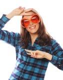 Speelse jonge vrouw met grote partijglazen Stock Afbeelding