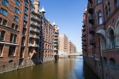 Speicherstadt in Hamburg, Germany. Old architecture around a canal in the Speicherstadt in Hamburg, Germany Stock Photo