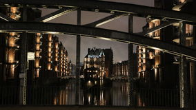Speicherstadt Hamburg at night, bridge in foreground. Royalty Free Stock Photos