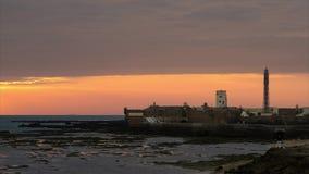 Spektakularny zmierzch na Świątobliwym Sebastian kasztelu Cadiz Hiszpania upływie zbiory