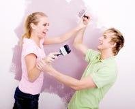 Spel-bestrijdt van het paar met verf Stock Foto's
