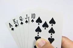 Spel van kaarten met pook van Koninklijke Vloed Stock Foto's