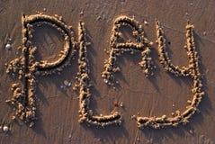 Spel in zand wordt geschreven dat Stock Afbeeldingen