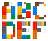 Spela bokstäver för tegelstenleksakalfabet Arkivbilder
