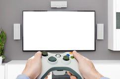Spela den modiga lekvideoen på tv eller bildskärm Gamerbegrepp Arkivfoto