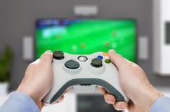 Spela den modiga lekvideoen på tv eller bildskärm Gamerbegrepp Royaltyfri Foto