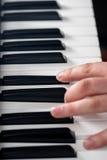 Spela för piano Arkivbild