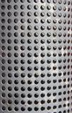 spela golfboll i hål metall för bakgrund perforated rastret Royaltyfria Foton