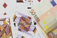 Spela kort och kontant studiofotografi för euro Royaltyfri Fotografi