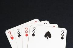 Spela kortet, fyra av kort för en sort Arkivbild