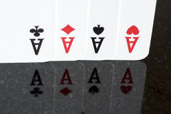 Spela kortet, fyra som en sort gör ett ess på Royaltyfri Bild
