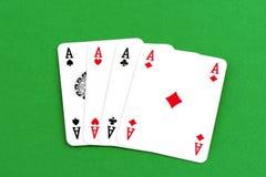 Spela kortet, fyra som en sort gör ett ess på Royaltyfria Foton