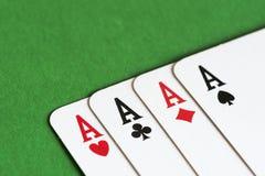 Spela kortet, fyra som en sort gör ett ess på royaltyfri fotografi