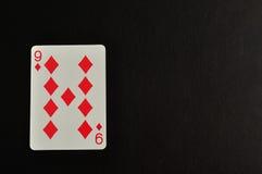 Spela kortet Nio av diamanten Arkivbilder