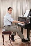 Spela pianot Fotografering för Bildbyråer