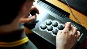 Spelare med ett pinnegalleri lager videofilmer