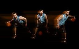 Spelare som dreglar en basket arkivfoton