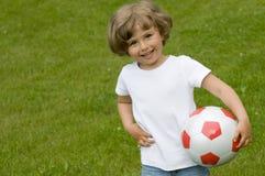 spelarefotbollbarn Arkivfoto