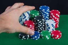 Spelaren segrar handbanken tar alla chiper Royaltyfria Bilder