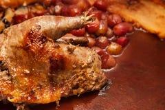 Spelcookery.roast fazant met druif Stock Fotografie