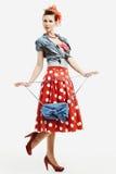 Speld-op jonge vrouw in uitstekende Amerikaanse stijl met een koppeling Stock Foto