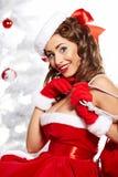 Speld-op meisje dat de kleren van de Kerstman draagt stock afbeeldingen