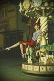 Speld op Meisje en carrousel Stock Foto