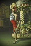 Speld op Meisje en carrousel Stock Afbeelding