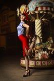 Speld op Meisje en carrousel Stock Fotografie