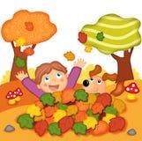 Spelen in de herfst Stock Foto's