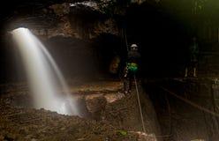 Speleologist Descending Into Mayei Cave. Speleologists At Mayei Cave The Cave Where The Wind Is Born Cueva Donde Nace El Viento In Ecuadorian Amazonia Waterfall Stock Photo