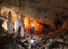 Speleologist exploring the cave Royalty Free Stock Photography
