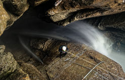 Speleologist Fixing The Entrance Route. Speleologist Inside Of Mayei Cave Waterfall Entrance Shaft In Ecuadorian Amazonia Stock Images