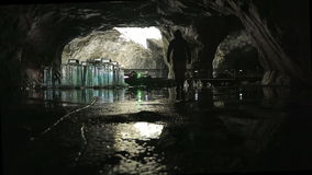 The speleologist goes across the ice of cave lake stock video