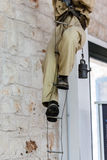 Speleologist. An old fashioned caver climbing up a rope ladder Stock Photography