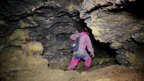 Speleologist take interview about karst cave stock video