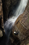 Speleologist And Underground Waterfall. Deep Waterfall Entrance Shaft At Mayei Cave In Ecuadorian Amazonia Stock Images