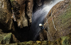 Speleologist And Underground Waterfall Stock Images