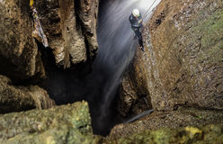 Speleologist And Underground Waterfall Stock Photos